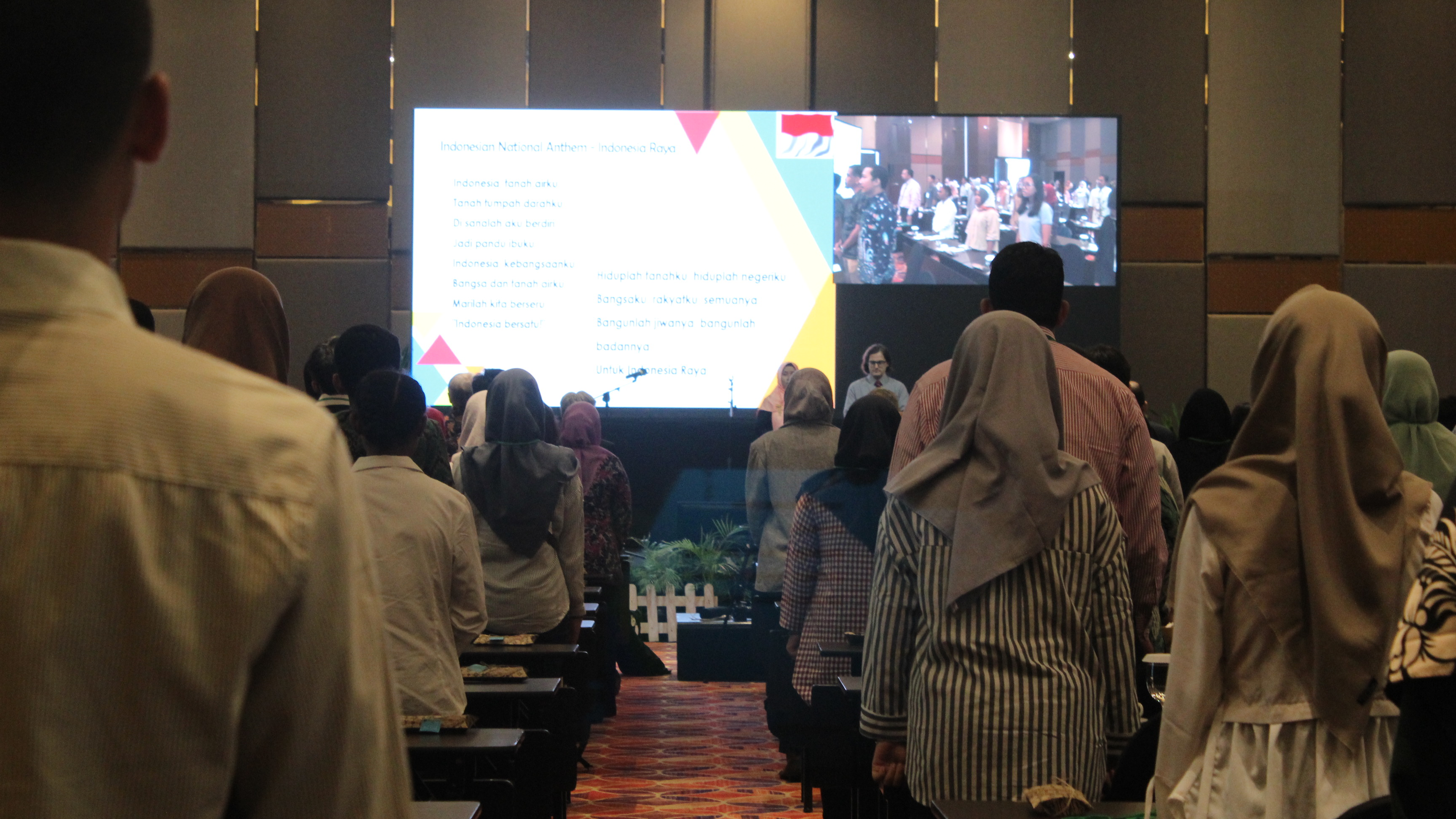 Singing Indonesia Athem together (all participants, speakers, and committees